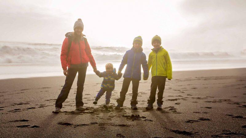 Iceland Family Travel on the black sand beach
