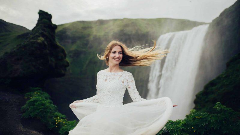wedding photo shoot at Skogafoss waterfall in Iceland