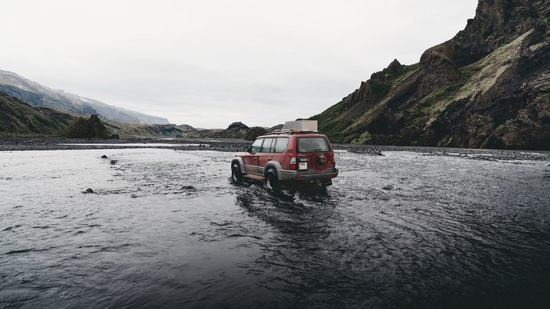 jeep driving over a river in Iceland