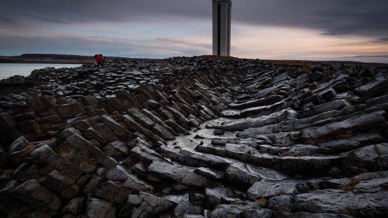 Kálfshamarsvíkurviti lighthouse in north Iceland - Kálfshamarsvíkur cove basalt columns
