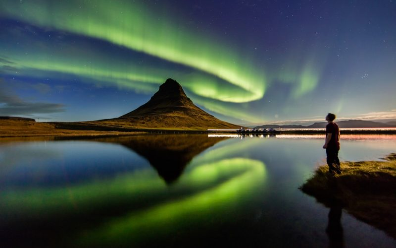 northern lights aurora borealis dancing over Kirkjufell mountain and Kirkjufellsfoss waterfall in Snæfellsnes Peninsula