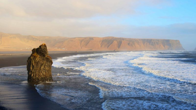 Kirkjufjara black sand beach and Eagle Rock in south Iceland