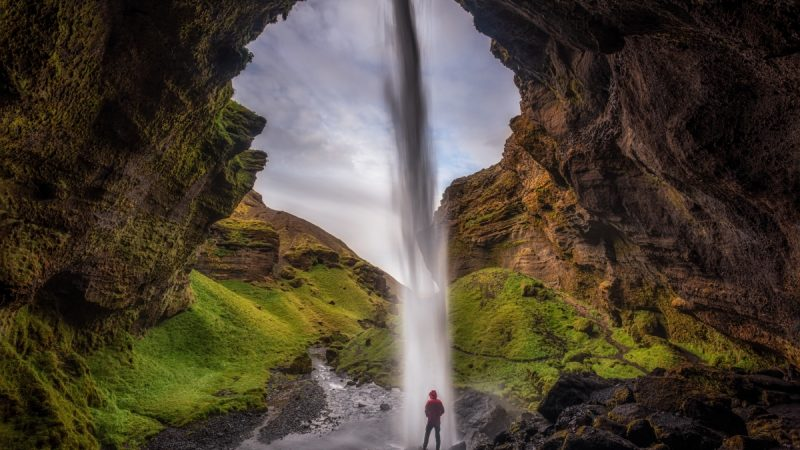 Kvernufoss waterfall during summer in Iceland, walk behind waterfall in south Iceland, hidden waterfall in south Iceland