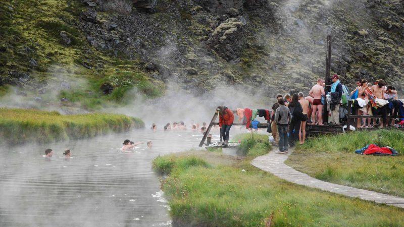people bathing in Landmannalaugar hot springs