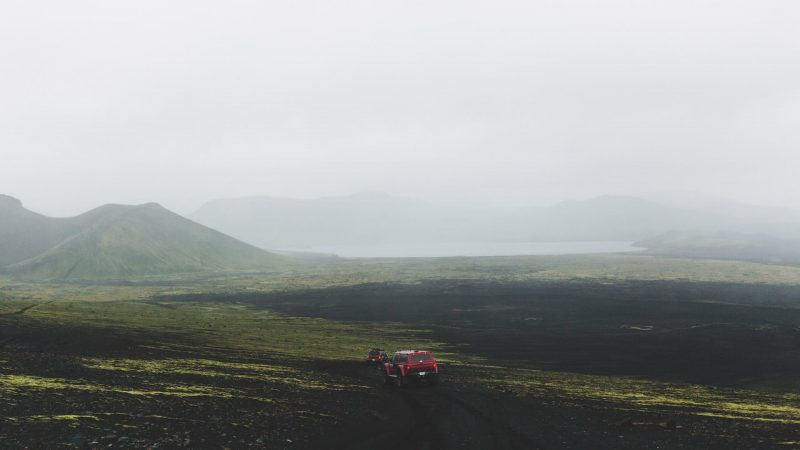 red super jeep driving in the highlands of Iceland on the way to Landmannalaugar
