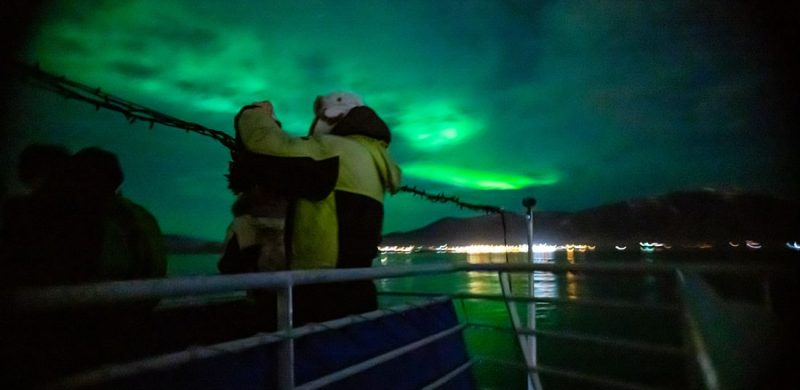 Northern Lights by boat, northern lights seen from sea in Reykjavik Iceland