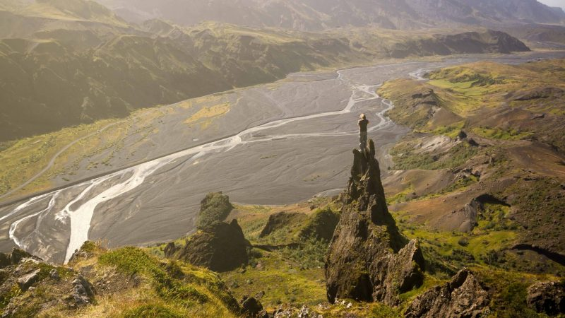 Photography in Iceland - photographer standing on top of a cliff in Thorsmork highlands of Iceland
