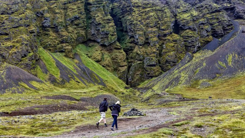 two man walking up to Rauðfeldsgjá Gorge in Snæfellsnes Peninsula