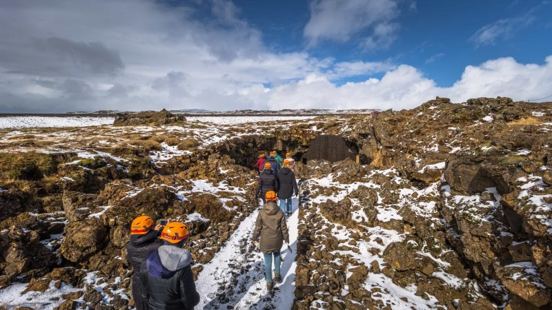 people on the way to Raufarhólshellir lava cave in Iceland