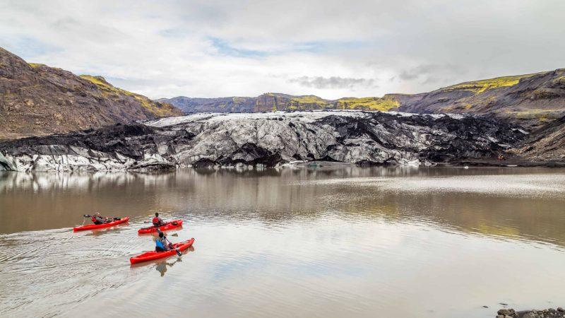 kayaking on Sólheimajokull glacier lagoon in south Iceland