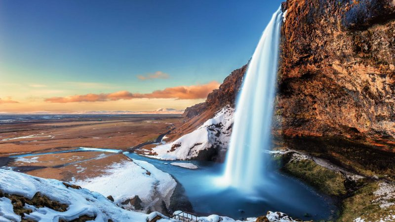 winter and snow at Seljalandsfoss walk behind waterfall in south Iceland