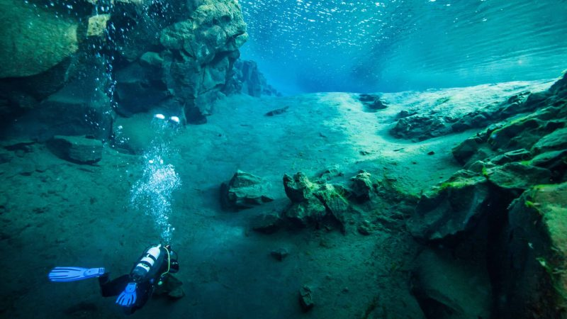 diving in Silfra fissure in Þingvellir National Park, the rift between continents in Iceland north America and Europe