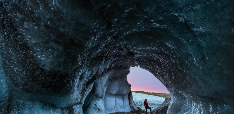 woman in an ice cave in Glacier Hiking in Skaftafell National Park