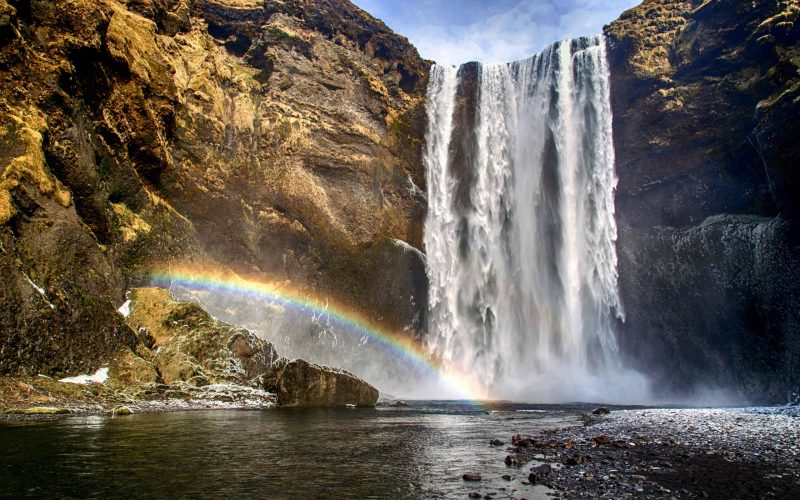 rainbow at Skógafoss waterfall in south Iceland