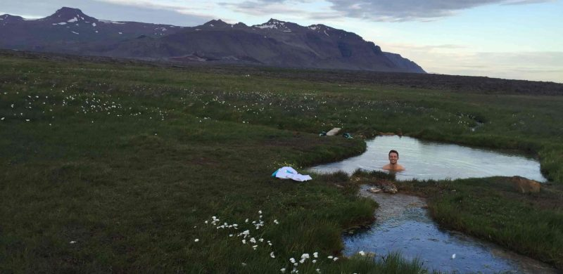 Sturlungalaug hot spring in Snæfellsnes Peninsula, hidden hot spring in Iceland with a view of the mountains
