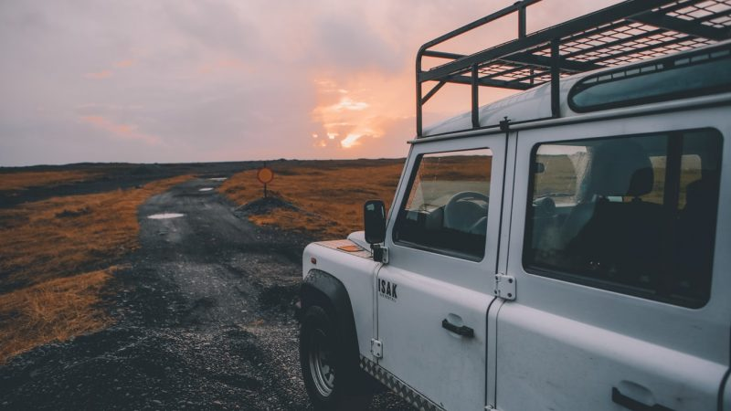 white jeep with sunset in Iceland