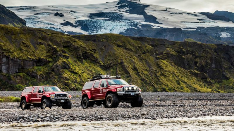 Super Jeep driving over a river on the way to Þórsmörk in the highlands of Iceland