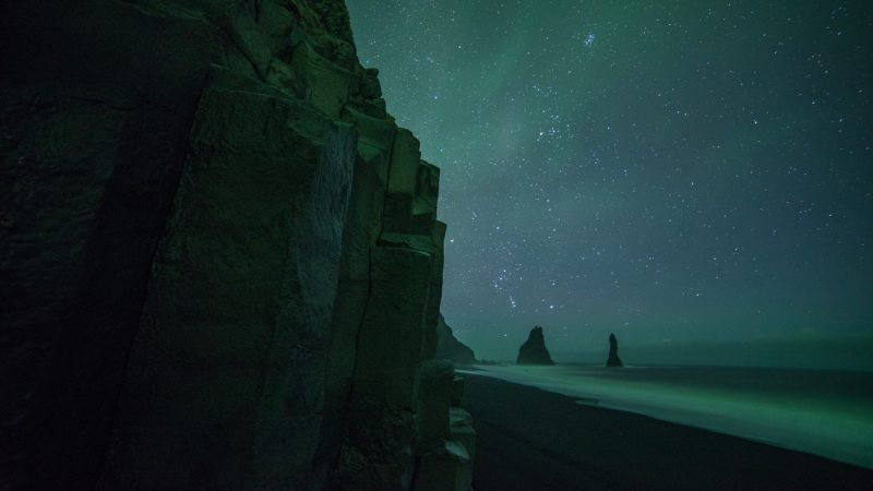 northern lights over Reynisfjara black sand beach
