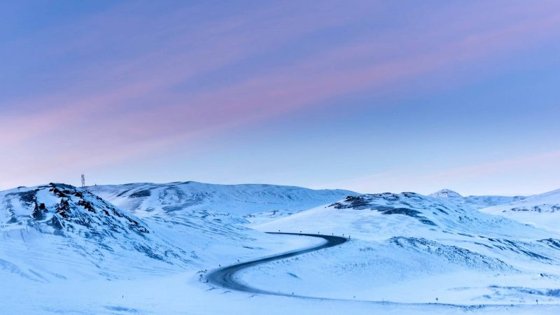 winter road trip in Iceland in snow and pink skies
