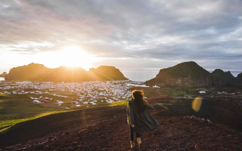 girl standing with a view over Vestmannaeyjar Westman Islands in south Iceland
