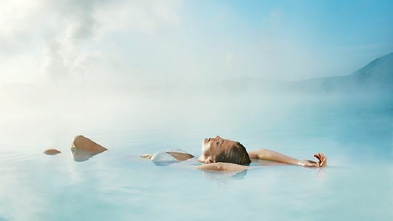 woman floating in the Blue Lagoon in Iceland