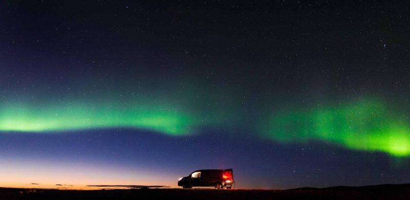 Happy Campers camper van under the northern lights in Iceland