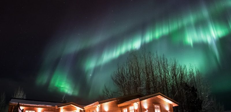 northern lights above a cabin in Iceland