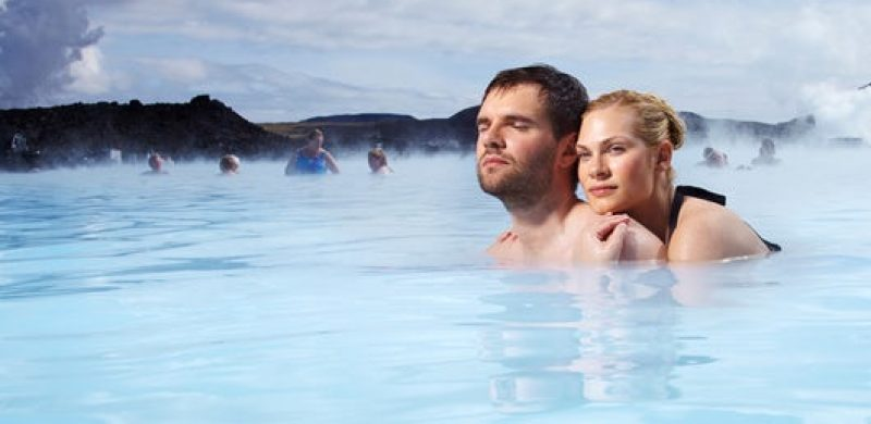 A couple bathing in the Blue Lagoon in Iceland