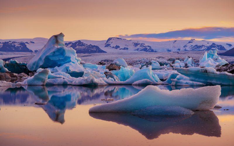 Midnight sun at Jokulsarlon glacier lagoon in south Iceland
